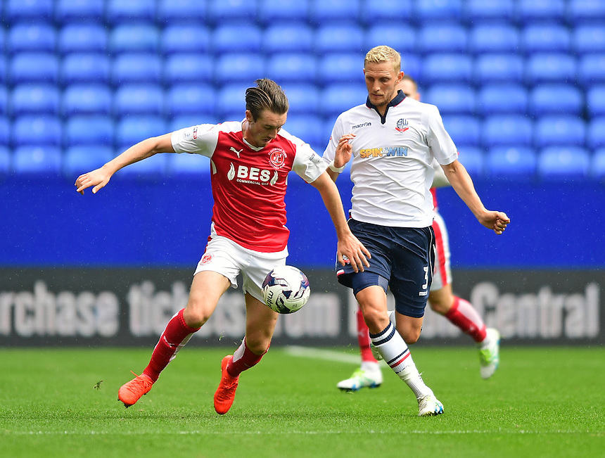 Fleetwood Town's Chris Long is tackled by Bolton Wanderers's Dean Moxey<br /> <br /> Photographer Chris Vaughan/CameraSport<br /> <br /> Football - The EFL Sky Bet League One - Bolton Wanderers v Fleetwood Town - Saturday 20 August 2016 - Macron Stadium - Bolton<br /> <br /> World Copyright &copy; 2016 CameraSport. All rights reserved. 43 Linden Ave. Countesthorpe. Leicester. England. LE8 5PG - Tel: +44 (0) 116 277 4147 - admin@camerasport.com - www.camerasport.com