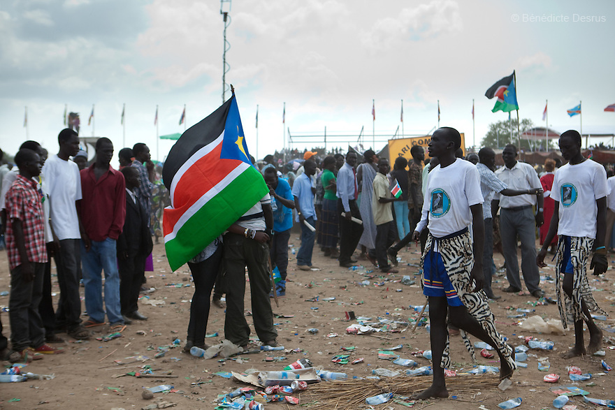 Saturday 9 july 2011 - Juba, Republic of South Sudan - South Sudanese hold the flag of their new country during South Sudan's independence day celebrations in Juba. Tens of thousands of citizens of the new South Sudan celebrate national independence but whether statehood will resolve issues of identity after a decades-long war remains to be seen. Photo credit: Benedicte Desrus