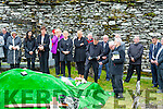 Liam O'Connor plays 'The Boys of Barr na Sraide' at the graveside of Mike Murphy as the 'The Iron Man' is laid to rest in Sugrena on Monday.