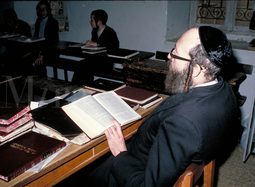 This is a Rabbi (a Jewish religious leader) reading lessons in Mea Shearim, the section of Jerusalem where the ultra-orthodox Jews live. Jerusalem, Israel Mea Shearim.