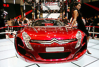 A model leans on a Citroen concept car at the Auto Shanghai 2007 in Shanghai, China. Auto shows in major Chinese cities such as Shanghai and Beijing are quickly gaining importance as automakers vie to capture the attention of Chinese consumers in all segments of the industry, from subcompacts to ultra luxurious models..