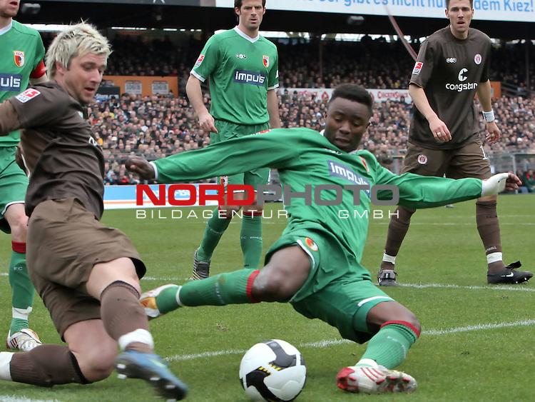 2.Liga FBL 2008/2009  25.Spieltag R&uuml;ckrunde<br /> FC St.Pauli vs. FC Augsburg<br /> <br /> <br /> Andrew Sinkala (Nr.23) rettet vor Bj&ouml;rn Brunnemann (Nr.5).<br /> <br /> <br /> Foto &copy; nph (nordphoto)<br /> <br /> *** Local Caption ***