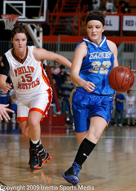 RAPID CITY, SD - MARCH 3, 2009 --  Torrie Trask #32 of Wall dribbles past Kenzy Pinney #15 of Philip during their Region 7B championship game Tuesday evening at the Barnett Arena in Rapid City. (Photo by Dick Carlson/Inertia)