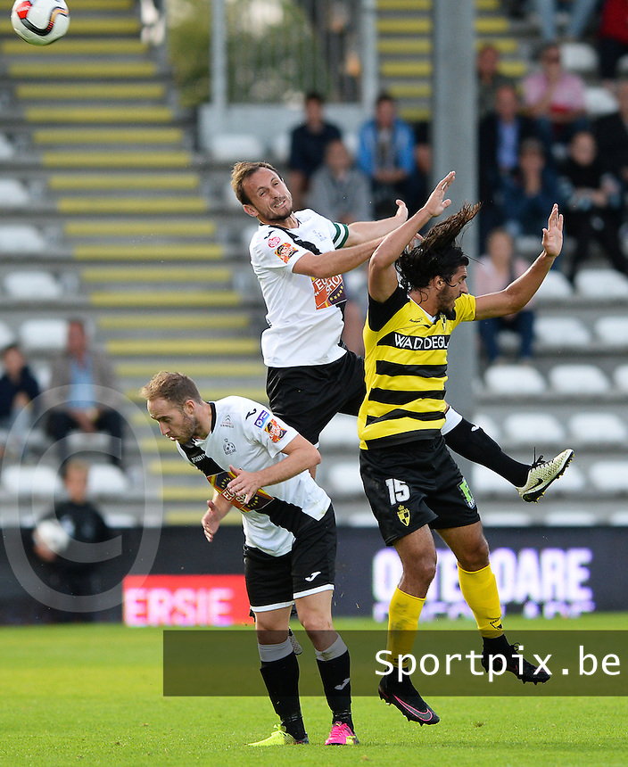 20160805 - ROESELARE , BELGIUM : Roeselare's Mickael Seoudi (middle) pictured in a duel with Roeselare's Raphael Lecomte (left) and Lierse's Amr Barakat Elbolasy (right) during a soccer game between KSV Roeselare and Lierse SK during the first matchday of the Proximus League 1B in the 2016-2017 season , friday 5 August 2016 , at stadion Schiervelde in Roeselare . PHOTO David Catry | Sportpix.Be