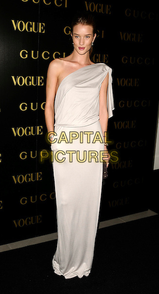 ROSIE HUNTINGDON-WHITELEY.A dinner in honour of Frida Gianni, Creative Director of Gucci, hosted by Alexandra Shulmanand at the Saatchi Gallery, Duke of York's Headquarters, King's Road, Chelsea, London, England..April 1st, 2009 .Vogue full length white dress grey gray silver silk satin  long maxi hand in pocket one shoulder .CAP/CAN.©Can Nguyen/Capital Pictures.