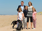 King Willem-Alexander of the Netherlands (L) and his wife Queen Maxima (R) and their children Amalia, Alexia and Ariane pose for photographers during a photo session on the beach near Wassenaar, the Netherlands, July 10, 2015. © Michael Kooren