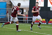 James Collins of Northampton Town (right) is congratulated by Marc Richards of Northampton Town (left) after scoring the opening goal against Morecambe during the Sky Bet League 2 match between Northampton Town and Morecambe at Sixfields Stadium, Northampton, England on 23 January 2016. Photo by David Horn / PRiME Media Images.