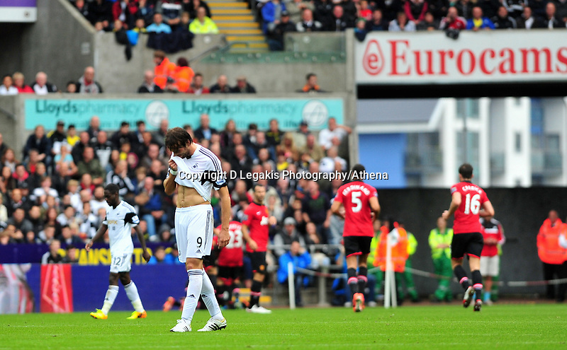 Manchester united score their first goal, scored by Robin Van Persie.<br /> Saturday 17 August 2013<br /> Pictured: <br /> Re: Barclays Premier League Swansea City v Manchester United at the Liberty Stadium, Swansea, Wales