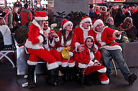 People dressed as santa claus gather in Times Square as they take part during the SantaCon party in New York, United States. 15/12/2012. Photo by Kena Betancur/VIEWpress.