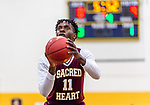 WATERBURY, CT. 09 December 2018-120918 - Sacred Heart forward Jammal Waters #11 shoots a free throw during the annual Waterbury Boys Basketball Jamboree at Kennedy High School in Waterbury on Sunday. Bill Shettle Republican-American