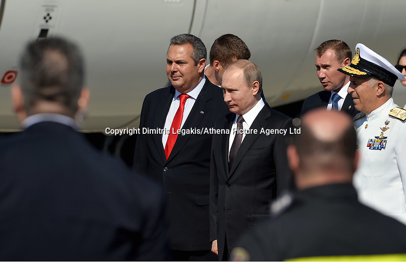 Pictured: Vladimir Putin with Panayiotis Kamenos (L) during his arrival to Athens Friday 27 May 2016<br /> Re: Russian President Vladimir Putin arrives at Eleftherios Venizelos Airport near Athens, Greece