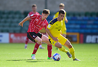 Lincoln City's Conor McGrandles battles with Oxford United's Cameron Brannagan<br /> <br /> Photographer Andrew Vaughan/CameraSport<br /> <br /> The EFL Sky Bet League One - Saturday 12th September  2020 - Lincoln City v Oxford United - LNER Stadium - Lincoln<br /> <br /> World Copyright © 2020 CameraSport. All rights reserved. 43 Linden Ave. Countesthorpe. Leicester. England. LE8 5PG - Tel: +44 (0) 116 277 4147 - admin@camerasport.com - www.camerasport.com - Lincoln City v Oxford United