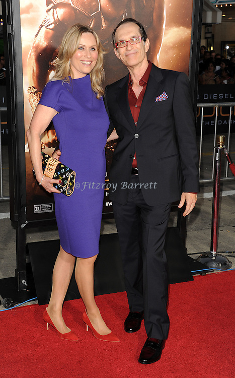 David Twohy and date at the RIDDICK World Premiere, held at the Regency Village Theater Los Angeles, Ca. August 28, 2013