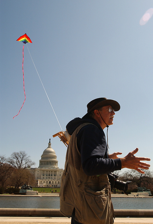 Bob Gathany of Huntsville, Ala., flies a 28-foot across Delta kite, on the Mall, Monday.  Gathany, a news photographer for his hometown paper, was in town to photograph the cherry blossoms and fly his kite in the festival over the weekend, but bad weather cut short both events.