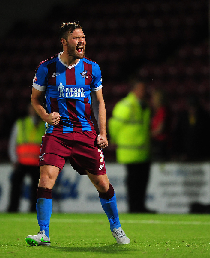 Scunthorpe United's Scott Laird celebrates scoring during the penalty shoot out<br /> <br /> Photographer Chris Vaughan/CameraSport<br /> <br /> Football - Capital One Cup First Round - Scunthorpe United v Barnsley - Tuesday 11th August 2015 - Glanford Park - Scunthorpe<br />  <br /> &copy; CameraSport - 43 Linden Ave. Countesthorpe. Leicester. England. LE8 5PG - Tel: +44 (0) 116 277 4147 - admin@camerasport.com - www.camerasport.com