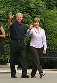 Washington, D.C. - June 19, 2007 -- United States President George W. Bush, left, and First Lady Laura Bush, right, arrive at the Congressional Picnic on the South Lawn of The White House in Washington DC, Tuesday, June 19, 2007. <br /> Credit: Chris Kleponis - Pool via CNP