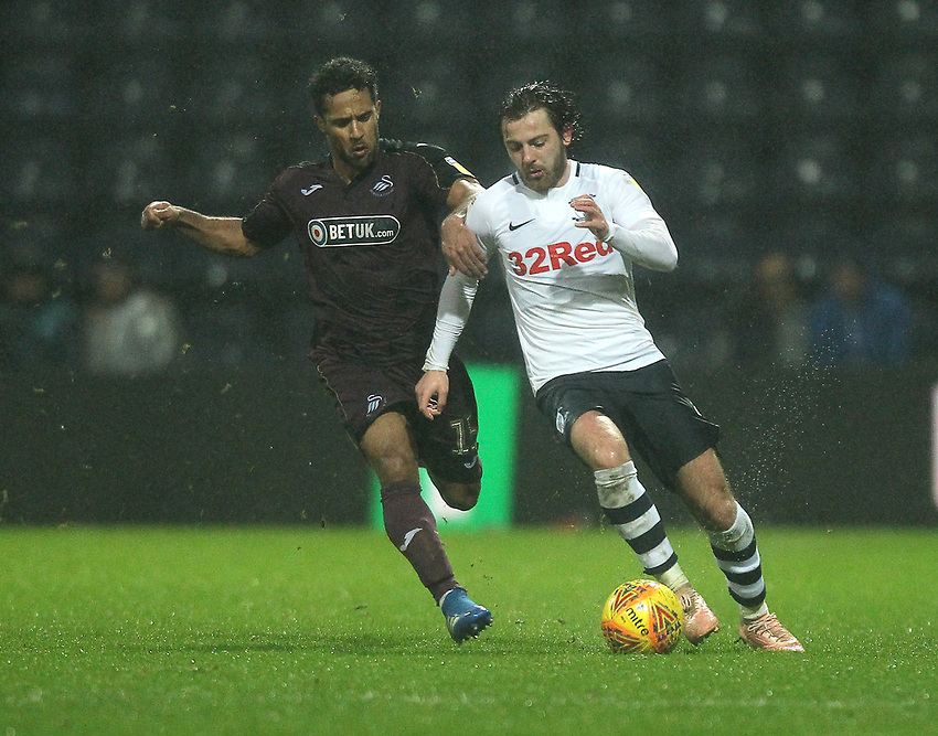Preston North End's Ben Pearson battles with  Swansea City's Wayne Routledge<br /> <br /> Photographer Mick Walker/CameraSport<br /> <br /> The EFL Sky Bet Championship - Preston North End v Swansea City - Saturday 12th January 2019 - Deepdale Stadium - Preston<br /> <br /> World Copyright © 2019 CameraSport. All rights reserved. 43 Linden Ave. Countesthorpe. Leicester. England. LE8 5PG - Tel: +44 (0) 116 277 4147 - admin@camerasport.com - www.camerasport.com