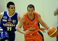 aints guard Jordan Mills chases Mark Dickel.S NBL - Wellington Saints v Southland Sharks at TSB Bank Arena, Wellington, New Zealand on Friday, 22 April 2011. Photo: Dave Lintott / lintottphoto.co.nz
