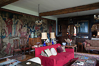 Mortlake tapestries of The Acts of the Apostles cover one wall in The Long Room at Hilles and portraits cover the wood panelled wall that opens into The Big Hall