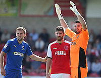Fleetwood Town's Ched Evans closely marked by Wimbledon's Ben Purrington and goalkeeper Tom King<br /> <br /> Photographer Stephen White/CameraSport<br /> <br /> The EFL Sky Bet League One - Fleetwood Town v AFC Wimbledon - Saturday 4th August 2018 - Highbury Stadium - Fleetwood<br /> <br /> World Copyright &copy; 2018 CameraSport. All rights reserved. 43 Linden Ave. Countesthorpe. Leicester. England. LE8 5PG - Tel: +44 (0) 116 277 4147 - admin@camerasport.com - www.camerasport.com