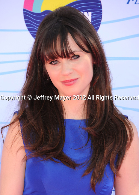 UNIVERSAL CITY, CA - JULY 22: Zooey Deschanel arrives at the 2012 Teen Choice Awards at Gibson Amphitheatre on July 22, 2012 in Universal City, California.