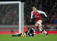 Alexis Sanchez of Arsenal leaves Mikel Merino of Newcastle United on the floor during the Premier League match between Arsenal and Newcastle United at the Emirates Stadium, London, England on 16 December 2017. Photo by Vince  Mignott / PRiME Media Images.