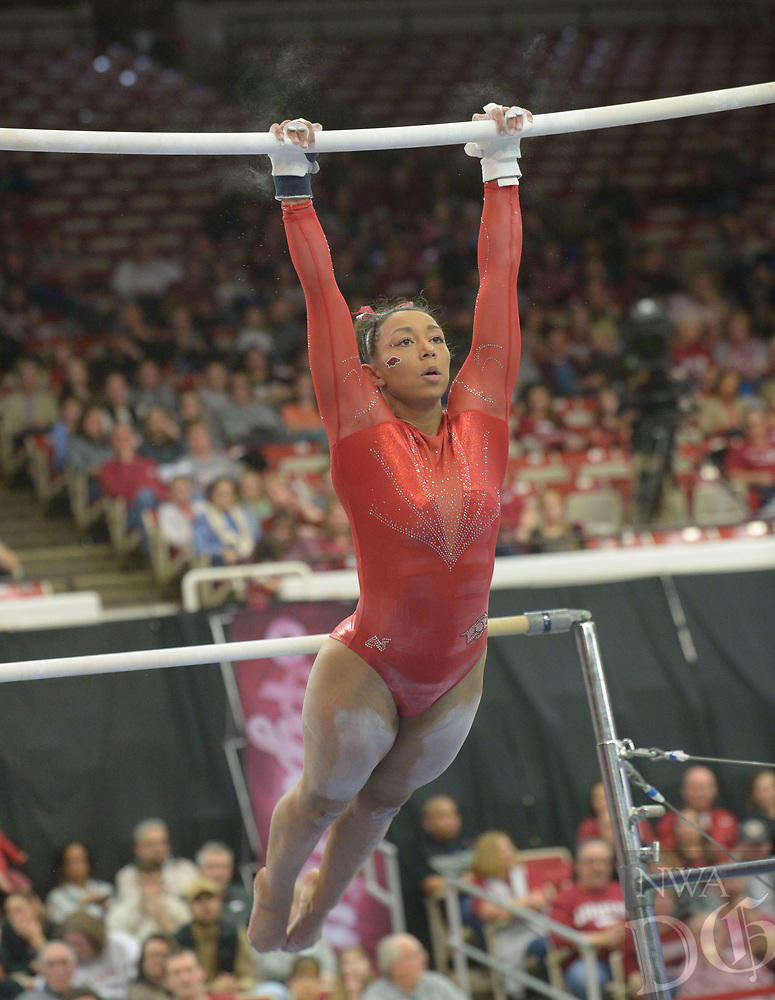 NWA Democrat-Gazette/ANDY SHUPE<br /> Arkansas' Michaela Burton competes in the bars Saturday, Jan. 5, 2019, during the Razorbacks' meet with No. 2 Oklahoma in Barnhill Arena in Fayetteville. Visit nwadg.com/photos to see more photographs from the meet.