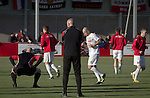 Home players going through their pre-match warm-up at Broadhurst Park, Manchester, the new home of FC United of Manchester before the club's match against Benfica, champions of Portugal, which marked the official opening of their new stadium. FC United Manchester were formed in 2005 by fans disillusioned by the takeover of Manchester United by the Glazer family from America. The club gained several promotions and played in National League North in the 2015-16 season, but lost this match 1-0.