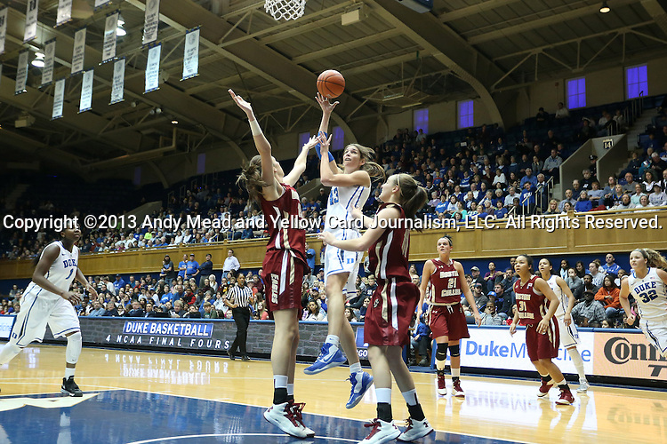 27 January 2013: Duke's Allison Vernerey (FRA) (43) shoots a layup over Boston College's Alexa Coulombe (13) and Nicole Boudreau (11). The Duke University Blue Devils played the Boston College Eagles at Cameron Indoor Stadium in Durham, North Carolina in an NCAA Division I Women's Basketball game. Duke won the game 80-56.
