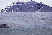 Mountain rising out of Glacier in Isfjorden on Spitzbergen Norway