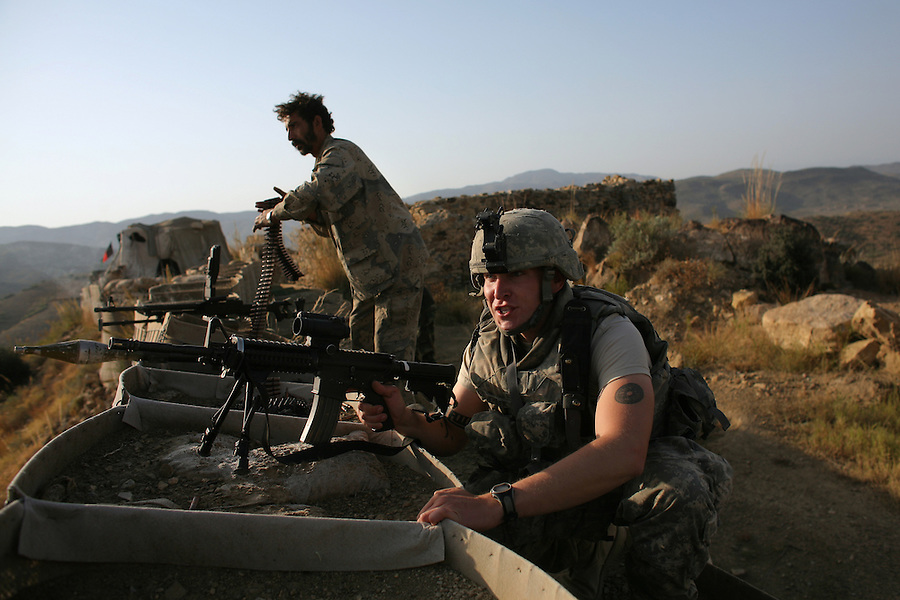 Afghan border police and soldiers from Alpha Battery 3-321 Field Artillery return fire during a Taliban attack on Border Security Post 7 in Afghanistan's eastern Khost Province on the Afghan-Pakistan border on Sunday Oct. 19, 2008.
