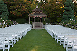 Woodland Park Rose Garden Gazebo with roses and white chairs for wedding