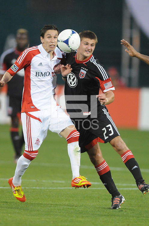 D.C. United midfielder Perry Kitchen (23) heads the ball against Toronto FC midfielder Eric Avila (8) D.C. United defeated Toronto FC 3-1 at RFK Stadium, Saturday May 19, 2012.