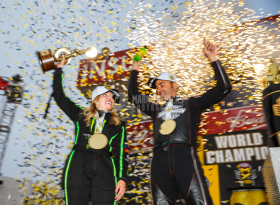 Nov 12, 2017; Pomona, CA, USA; NHRA top fuel driver Brittany Force (left) and pro stock motorcycle rider Eddie Krawiec celebrate after winning the 2017 world championships at Auto Club Raceway at Pomona. Mandatory Credit: Mark J. Rebilas-USA TODAY Sports