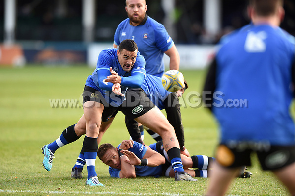 Kahn Fotuali'i of Bath Rugby passes the ball during the pre-match warm-up. Aviva Premiership match, between Bath Rugby and Harlequins on November 25, 2017 at the Recreation Ground in Bath, England. Photo by: Patrick Khachfe / Onside Images
