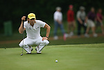 7 September 2008:    Camilo Villegas of Medellin, Colombia, South America lines up a putt on the ninth hole in the delayed third round of play at the BMW Golf Championship at Bellerive Country Club in Town & Country, Missouri, a suburb of St. Louis, Missouri on Sunday September 7, 2008. He and 23 other golfers had to finish their third round of competition Sunday morning before the fourth and final round could be played due to the suspension of third round play because of darkness on Saturday Sept. 6.  The BMW Championship is the third event of the PGA's  Fed Ex Cup Tour.