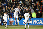 12 December 2014: Virginia's Riggs Lennon (12) and UMBC's Gregg Hauck (13) challenge for a header. The University of Virginia Cavaliers played the University of Maryland Baltimore County Retrievers at WakeMed Stadium in Cary, North Carolina in a 2014 NCAA Division I Men's College Cup semifinal match. Virginia won the game 1-0.