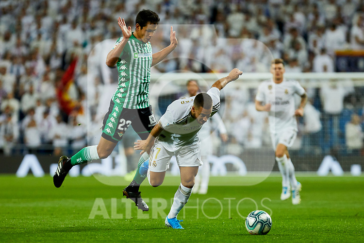 Eden Hazard of Real Madrid and Aissa Mandi of Real Betis Balompie during La Liga match between Real Madrid and Real Betis Balompie at Santiago Bernabeu Stadium in Madrid, Spain. November 02, 2019. (ALTERPHOTOS/A. Perez Meca)