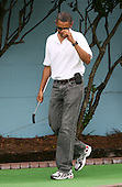 """United States President Barack Obama does a fake """"tip of the hat"""" after making a hole in one while playing miniature golf with First Lady Michelle and daughter Sasha at Pirate's Island Miniature Golf in Panama City Beach, Florida USA on Saturday, 14 August  2010.  The First Family is visiting the area to help promote tourism and check up on clean up efforts from the aftermath of the Deepwater Horizon Oil spill. .Credit: Dan Anderson / Pool via CNP"""