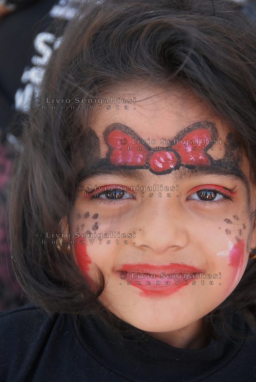 Kara Tepek / Lesbos / Greece 06/04/2016<br /> Asenat, 7 years old, born in Herat, Afghanistan. She is among the many children who fled the war and are now housed in a refugee camp in Greece. according to UNHCR kids official estimates are 40% of the refugees moving along the route Balkanica<br /> Photo Livio Senigalliesi