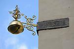 A golden bell on a street corner in Prague, Czech Republic.