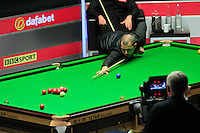 Barry Hawkins looks to cut in a red ball to into the right hand pocket during the Dafabet Masters FINAL between Barry Hawkins and Ronnie O'Sullivan at Alexandra Palace, London, England on 17 January 2016. Photo by Liam Smith / PRiME Media Images