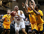 SIOUX FALLS, SD - MARCH 8:  Scott Schwieterman #15 from Indiana Tech looks for help while being surrounded by a trio of defenders from West Virginia University Tech at the 2018 NAIA DII Men's Basketball Championship at the Sanford Pentagon in Sioux Falls. (Photo by Dave Eggen/Inertia)