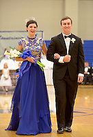 NWA Democrat-Gazette/BEN GOFF @NWABENGOFF<br /> Mackenzie Page and Joseph Sultemeier, homecoming queen and king, exit the gym on Friday Sept. 18, 2015 after the homecoming ceremony at Rogers High School.