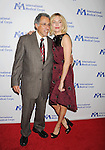 BEVERLY HILLS, CA- OCTOBER 23: Actress Sienna Miller (R) and International Medical Corps Founder Dr. Bob Simon arrive at the International Medical Corps' Annual Awards dinner ceremony at the Beverly Wilshire Four Seasons Hotel on October 23, 2014 in Beverly Hills, California.