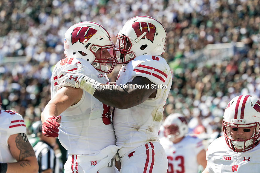 Wisconsin Badgers running back Corey Clement (6) celebrates a touchdown with teammate Troy Fumagali (81) during an NCAA college football game against the Michigan State Spartans Saturday, September 24, 2016, in East Lansing, Michigan. The Badgers won 30-6. (Photo by David Stluka)