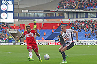 Middlesbrough's Britt Assombalonga and Bolton Wanderers' Craig Noone <br /> <br /> Photographer Rachel Holborn/CameraSport<br /> <br /> The EFL Sky Bet Championship - Bolton Wanderers v Middlesbrough - Saturday 9th September 2017 - Macron Stadium - Bolton<br /> <br /> World Copyright &copy; 2017 CameraSport. All rights reserved. 43 Linden Ave. Countesthorpe. Leicester. England. LE8 5PG - Tel: +44 (0) 116 277 4147 - admin@camerasport.com - www.camerasport.com