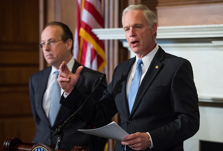 UNITED STATES - JANUARY 6: From left, Paul Clement, former United States Solicitor General, and Sen. Ron Johnson, R-Wisc., hold their news conference on Monday, Jan. 6, 2014, to announce lawsuit against the Office of Personnel Management challenging the Affordable Care Act regulation that allows congressional staff to keep their employer contributions for use toward the purchase of a health insurance plan. (Photo By Bill Clark/CQ Roll Call)