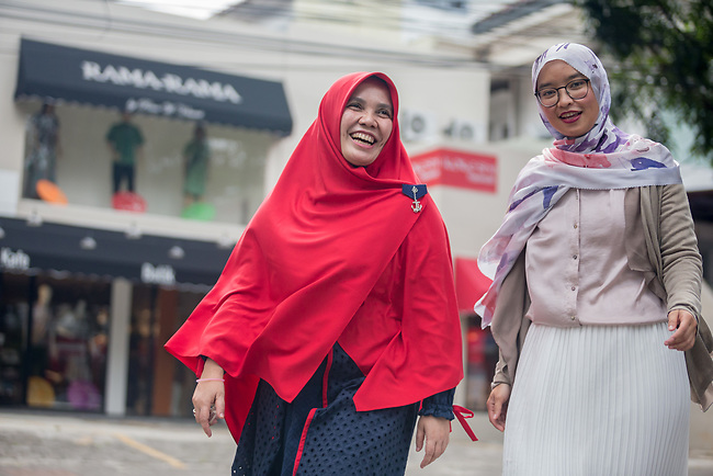 23 JAN, 2018, Jakarta, Indonesia: Irna Mutiara (48, left) founder of Islamic Fashion Institute with Marina Kuswa (30) an alumni and one of the first Institute students discussing the rise of Islamic fashion and the massive revenue boost the sector is bringing to the Indonesian economy and individual designers and industry as a whole. Pictured in Jakarta by Graham Crouch for Luzerner Zeitung