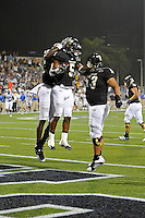 1 October 2011:  FIU wide receiver Dominique Rhymes (82), wide receiver Wayne Times (5) and center Giancarlo Revilla (53) celebrate Times' 34-yard touchdown reception in the fourth quarter as the Duke University Blue Devils defeated the FIU Golden Panthers, 31-27, at FIU Stadium in Miami, Florida.